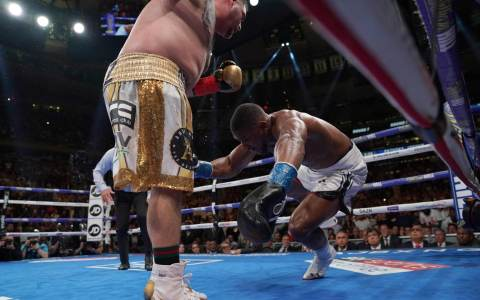 Andy Ruiz (L) knocks down England's Anthony Joshua (R) in the 7th round to win by TKO during their 12-round IBF, WBA, WBO & IBO World Heavyweight Championship fight at Madison Square Garden in New York on June 1, 2019