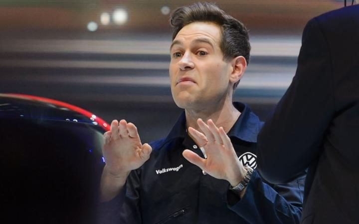 Comedian Simon Brodkin tried to install fraudulent Volkswagen software at Geneva motor show, AFP photo