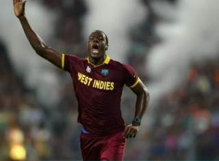 Carlos Brathwaite of the West Indies celebrates dismissing Joe Root of England during the ICC World Twenty20 India 2016