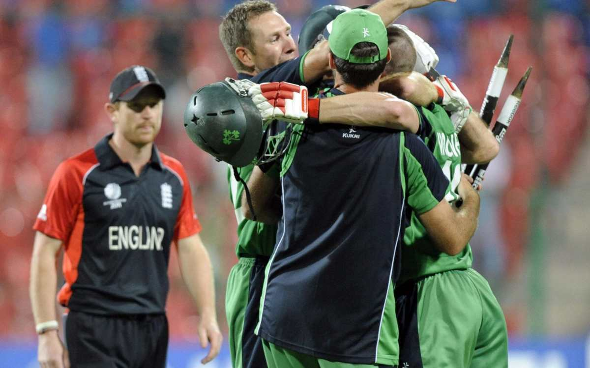 Ireland celebrate winning as England's Paul Collingwood watches on