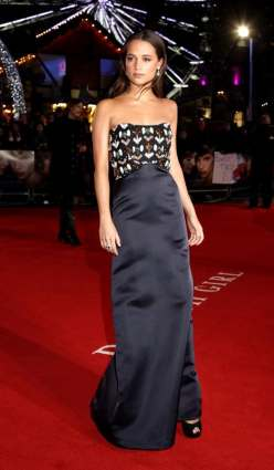 Vikander in Louis Vuitton at the UK premiere of The Danish Girl