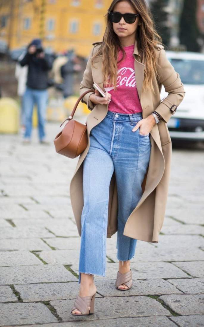 Miroslava Duma shows off this season's denim - faded blue, high-waisted, kick flare and cut off just above the ankle