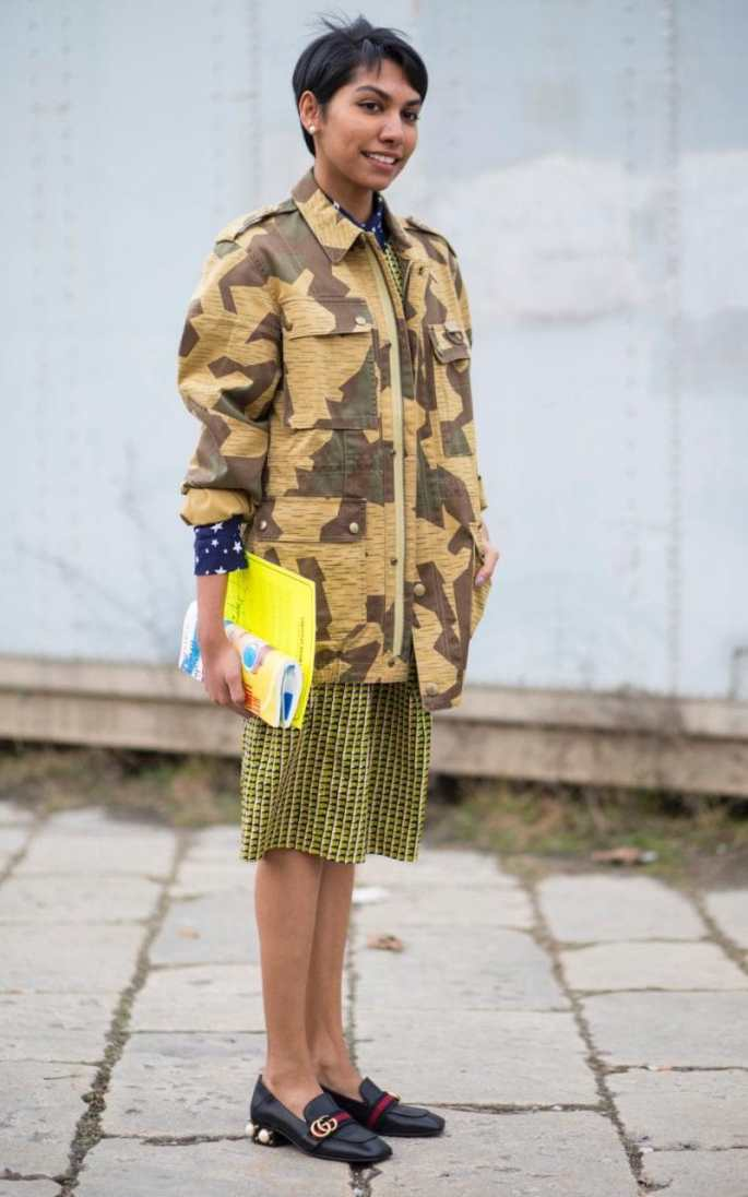 An army jacket is an ideal lightweight cover-up for spring-summer, and adds a fresh counterpoint to knee-length skirts as this showgoer demonstrates