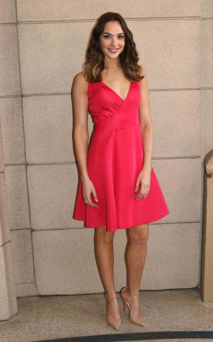 For a photocall in Los Angeles on March 16, the star chose a bright pink wrap dress with a skater skirt