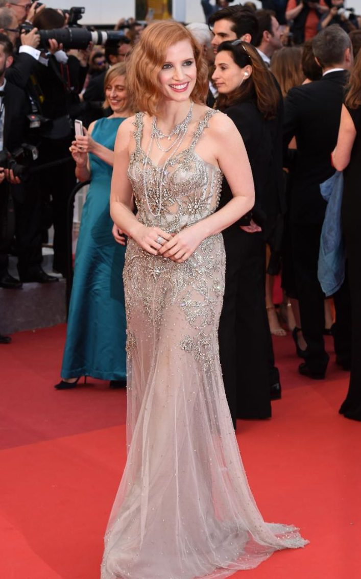 Jessica Chastain looks beautiful on the red carpet in a delicate nude tulle gown adorned in silver heavy embellishment