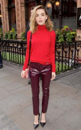 Mad Men star Kiernan Shipka stamped her fashion prowess at the pre-show party in high-shine burgundy trousers