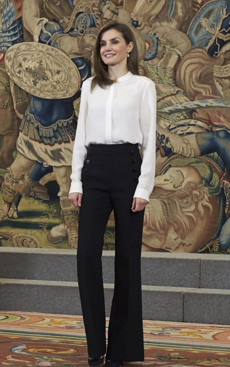 Queen Letizia of Spain wears flattering wideleg trousers  a cream blouse to attend an event at