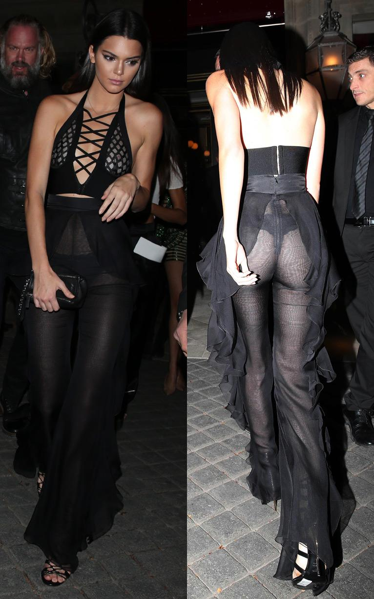 Kendall Jenner showed off her pert model assets in a sheer black Balmain ensemble on the first night of Paris SS16 Fashion Week