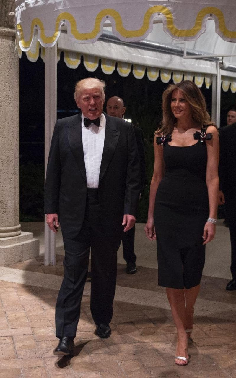 Melania Trump, wearing Dolce & Gabbana on New Year's Eve, with Donald Trump