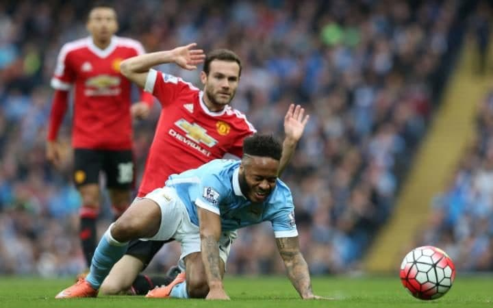 Sterling injured by Mata in a tackle in the Manchester derby