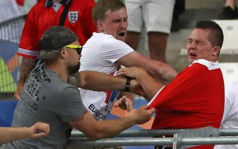 Two Russians attack an England fan