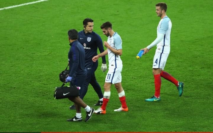 Adam Lallana of England recieves treatment before going off due to an injury during the international friendly match between England and Spain