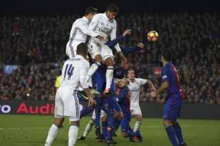 "Barcelona v Real Madrid - Spanish La Liga Santander- Nou Camp Stadium, Barcelona, Spain - 3/12/16. Real Madrid's Cristiano Ronaldo and Raphael Varane challenge Barcelona's Gerard Pique during the ""Clasico"". REUTERS/Sergio Perez"