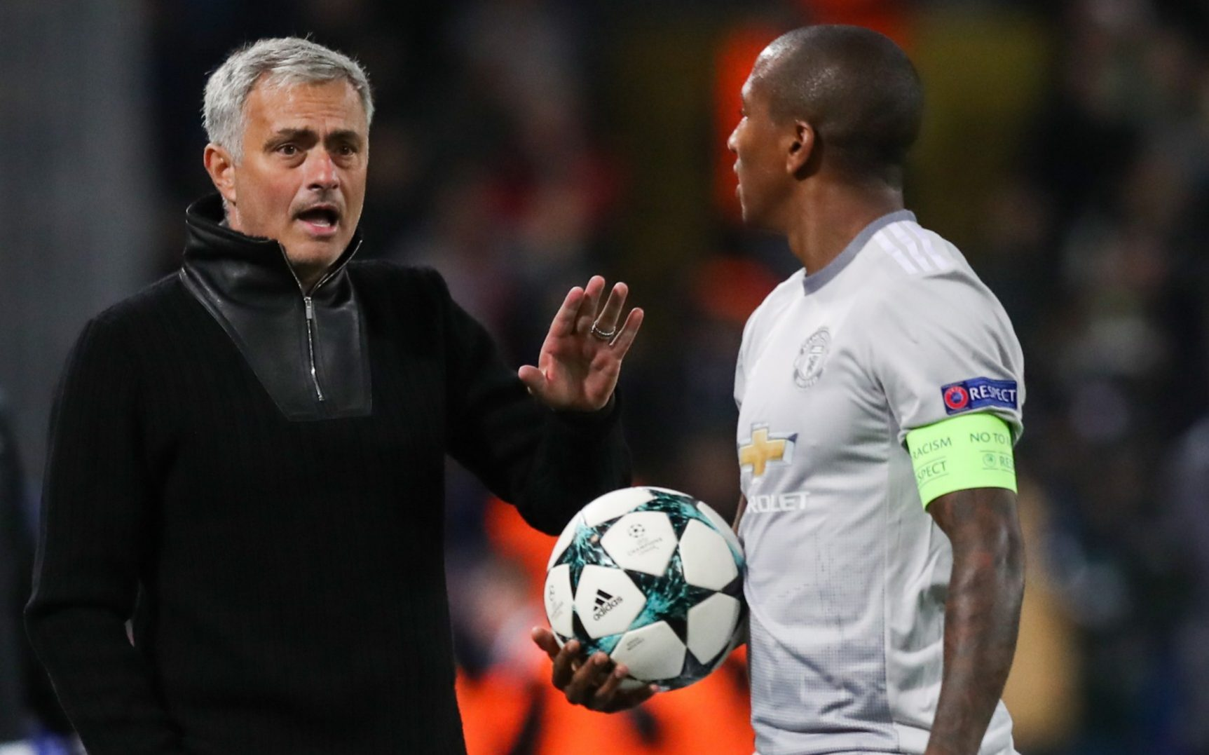 Ashley Young talks with Jose Mourinho