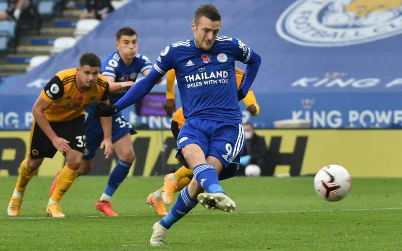 Leicester rise to the top after Jamie Vardy penalty settles gritty victory  over Wolves