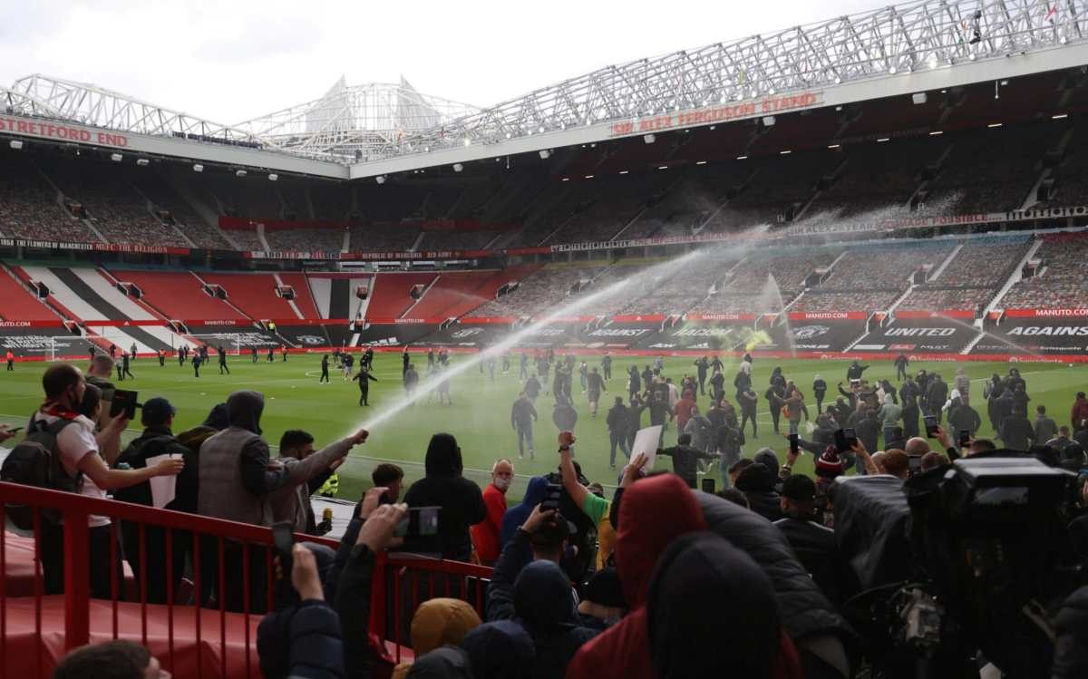 Carragher had a pitchside view as fans stormed the Old Trafford pitch