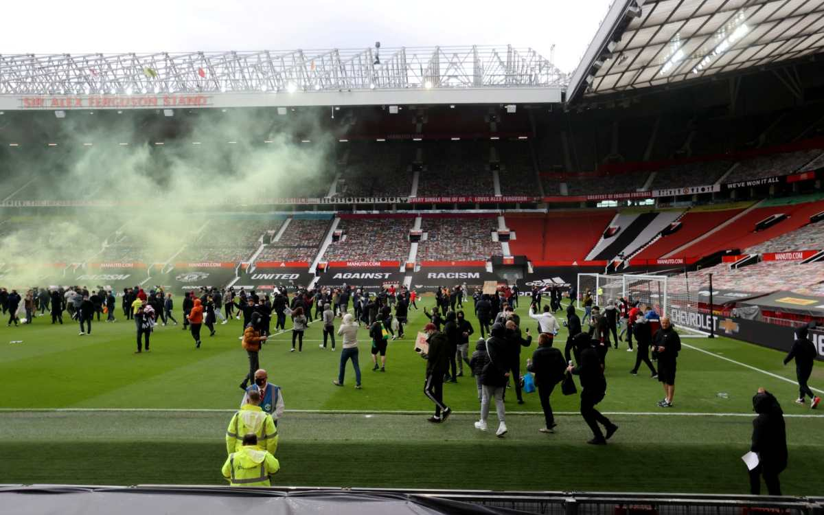 Manchester United fans protest against their owners before the Manchester United v Liverpool