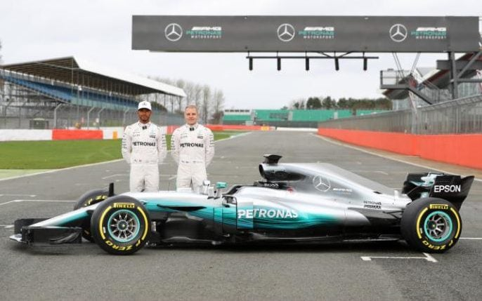 NORTHAMPTON, ENGLAND - FEBRUARY 23: Lewis Hamilton of Great Britain and Mercedes GP and Valtteri Bottas of Finland and Mercedes GP pose during the launch of the Mercedes formula one team's 2017 car, the W08, at Silverstone Circuit on February 23, 2017 in Northampton, England. (Photo by Mark Thompson/Getty Images)
