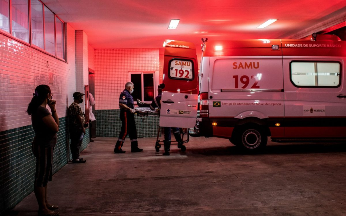 Nurses transport a patient infected with coronavirus to the 28 de Agosto Hospital in Manaus, as the health system is pushed to the brink