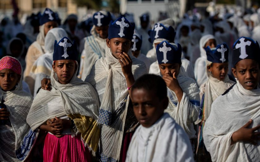Young members of the choir walk amongst congregants during a Sunday morning service of the Ethiopian Orthodox Tewahedo Church at the Church of St. Mary in Mekele, in the Tigray region of northern Ethiopia