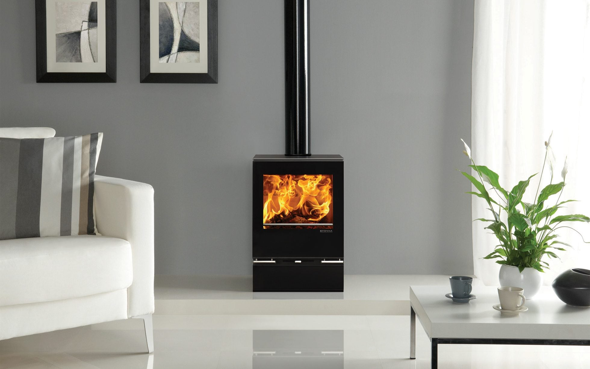 images of living rooms with wood burning stoves large room windows why the log stove is still in fashion