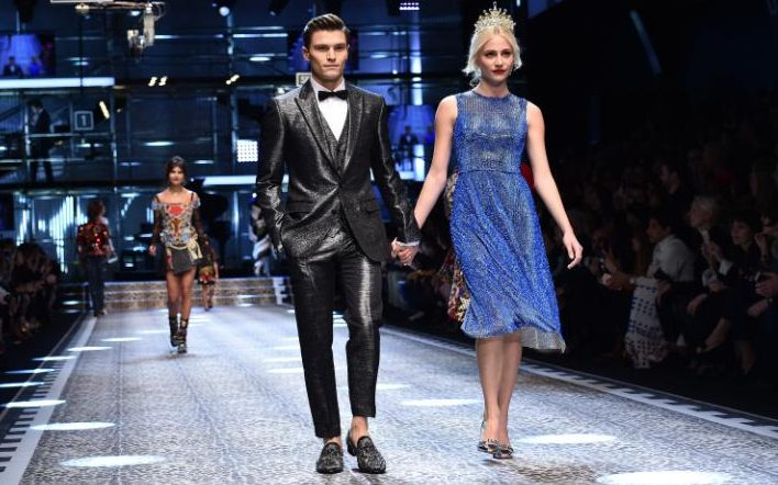Oliver Cheshire and Pixie Lott walk the runway in Milan