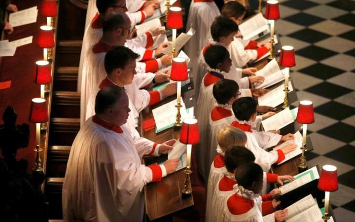 Choristers sing during a service for the inauguration of the Tenth General Synod, at Westminster Abbey in London, Britain November 24, 2015.