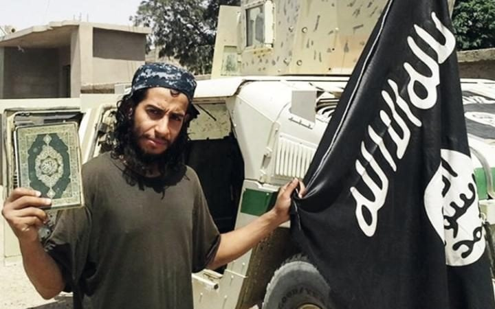 Abdelhamid Abaaoud, pictured with the Isil flag.
