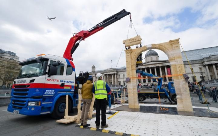 Workers put the finishing touches to the replica of Palmyra's Arch of Triumph in Trafalgar Square