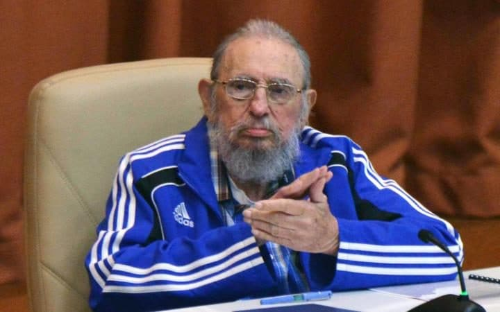 Fidel Castro applauding during the closing ceremony of VII Congress of Cuban Communist Party