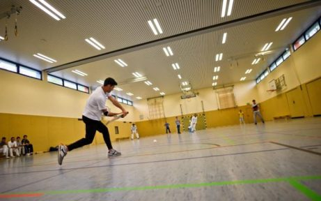 Refugees from Afghanistan take part in a training session in Essen