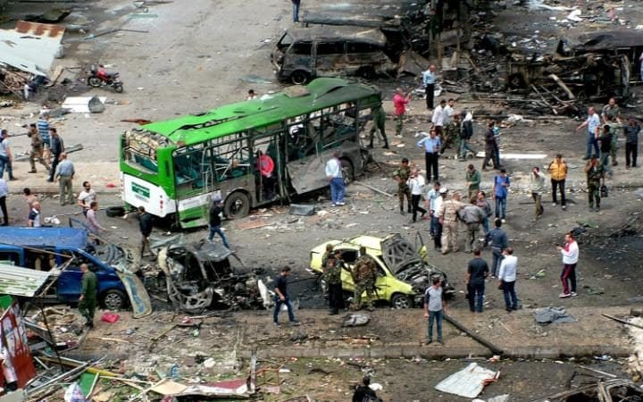 The site of the car bombing in a bus station in Jableh