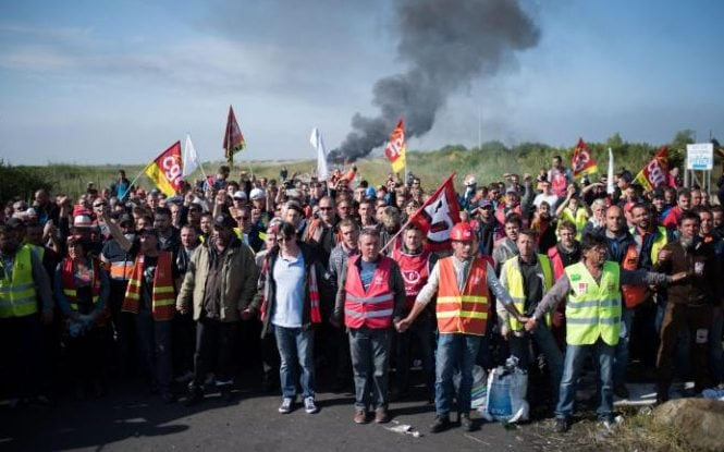Striking workers block access to an oil depot in Donges