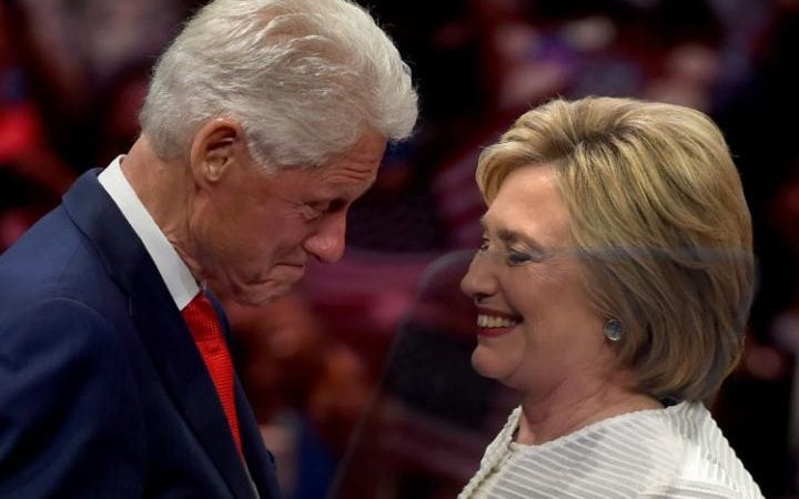 Democratic presidential candidate Hillary Clinton stands on stage with husband, former US president Bill Clinton during her primary night event at the Duggal Greenhouse, Brooklyn