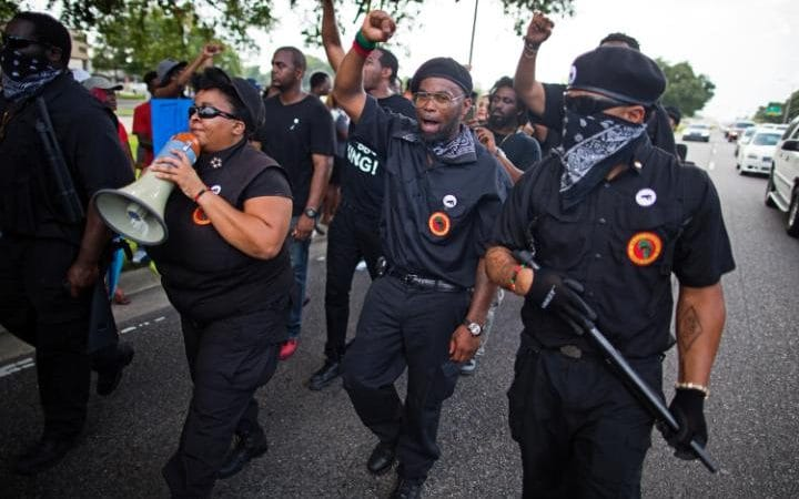 https://i0.wp.com/www.telegraph.co.uk/content/dam/news/2016/07/10/102894867_Members_of_the_New_Black_Panther_Party_march_in_front_of_the_Baton_Rouge_Police_Department-large_trans++ZgEkZX3M936N5BQK4Va8RWtT0gK_6EfZT336f62EI5U.jpg