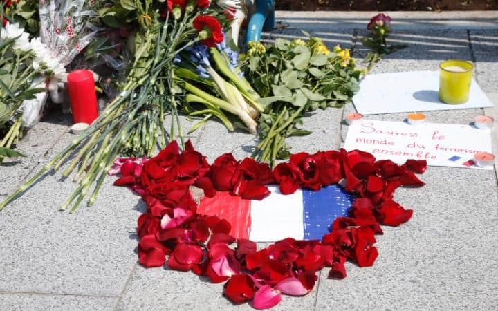 Flowers at tribute to the victims of the 14 July terrorist attack in Nice at a memorial place in front of French embassy in Moscow, Russia, 15 July 2016.