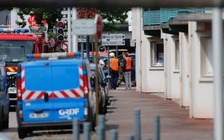 French police officers and firemen arrive at the scene of a hostage-taking at a church in Saint-Etienne-du-Rouvray