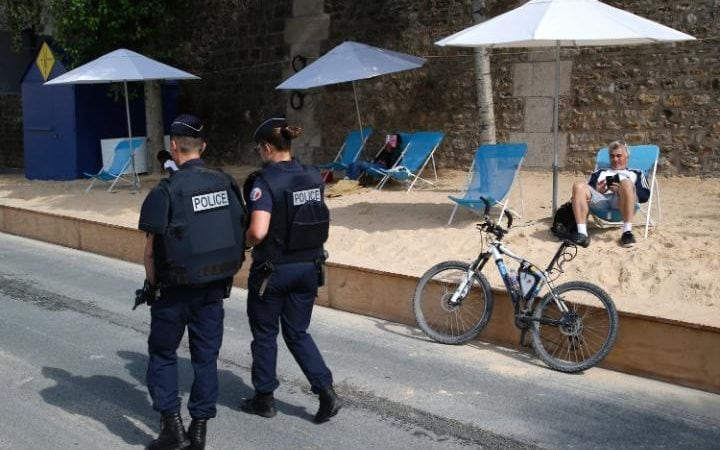 French police officers patrol at Paris Plage