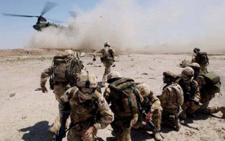 Soldiers from the The Royal Welch Fusiliers manning a helicopter borne Eagle VCP (Vehicle Check Point) on July 2, 2004 around the southern Iraqi town of Basra