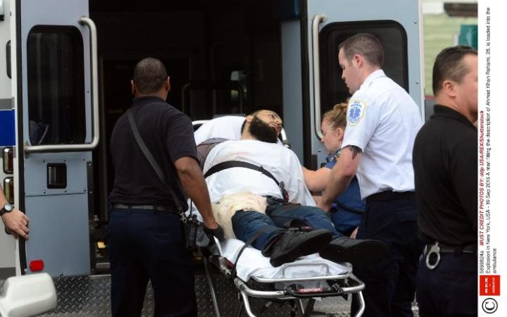 A man fitting the description of Ahmad Khan Rahami, 28, is loaded into the ambulance