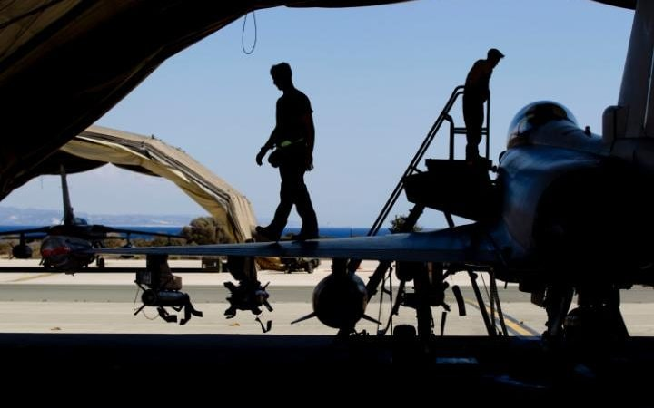Ground crew working on a Typhoon fighter bomber at RAF Akrotiri
