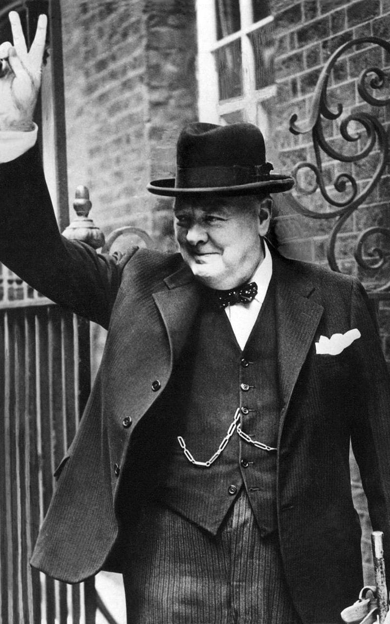 "Sir Winston Churchill, is photographed with the famous V for ""victory"" in 10 Downing Street after his return to London in 1943"