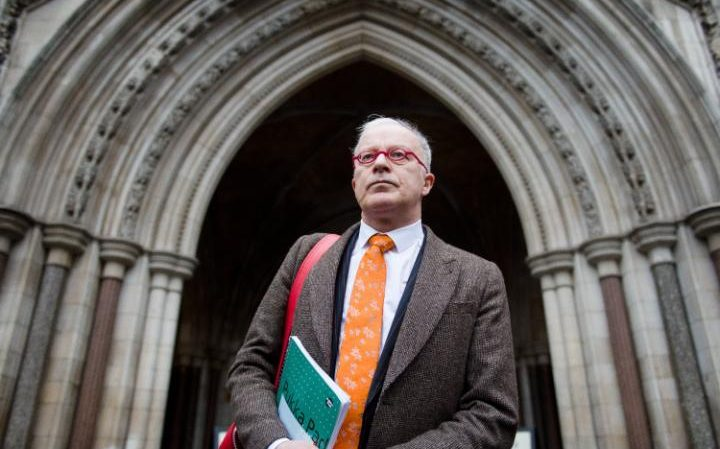 Phil Shiner of Public Interest Lawyers prepares to outline his case against the Ministry of Defence to members of the media as he stands outside the High Court in central London on January 29, 2013