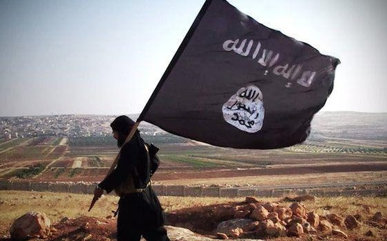 Jihadist carrying Isil flag in Syria