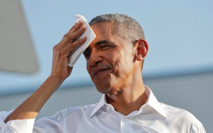 President Barack Obama wipes his forehead after speaking at the University of North Carolina in Chapel Hill, Wednesday, Nov. 2, 2016