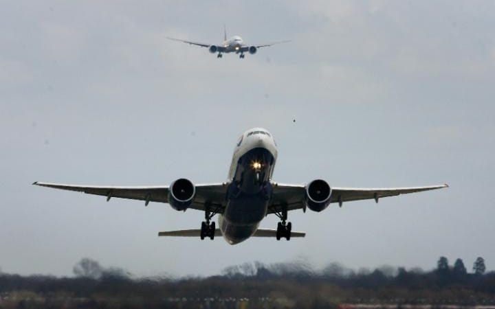 A BA Boeing 777 takes off from Gatwick, with another plane behind