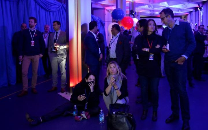 Guests at the US Embassy in London watch the results