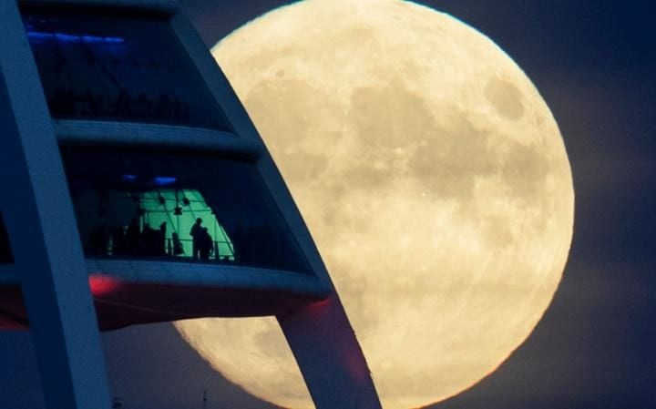 A spectacular moon rises beyond the Spinnaker Tower in Portsmouth