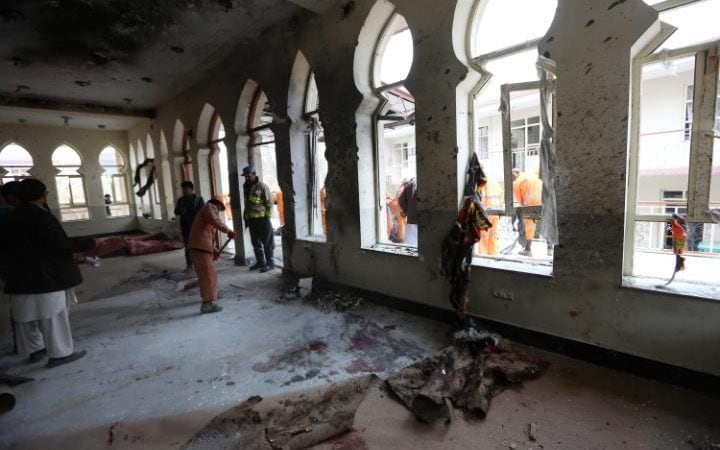 Afghan Municipality workers sweep Baqir-ul-Olum mosque after a suicide attack
