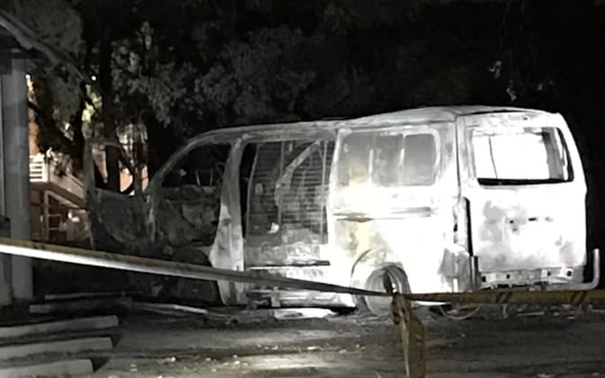 The burnt out van